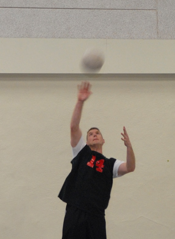 David Rose, a member of the 312th Training Squadron Fire Dawgs base volleyball team, serves the ball during an intramural volleyball match against the 316th Training Squadron Sharks Tuesday at the Carswell Field House. (U.S. Air Force photo by Tech. Sgt. Randy Mallard)