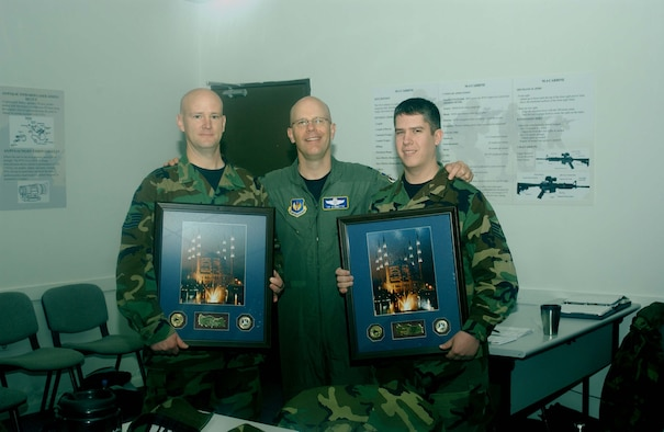 """Col. """"Tip"""" Stinnette, 39th Air Base Wing commander, stands between Tech. Sgt. Wade Schutt and Staff Sgt. Travis Baune, 39th Maintenance Squadron security managers, after they received the 39th Air Base Wing Security Manager of the Year program award for 2006. The two Team Incirlik members won the award for managing the best security program on base."""