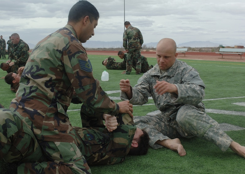 A Soldier from Fort Bliss, Texas, gives pointers to two Airmen during hand-to-hand combat training March 21 at Holloman. (U.S. Air Force photo by Airman 1st Class John Strong)