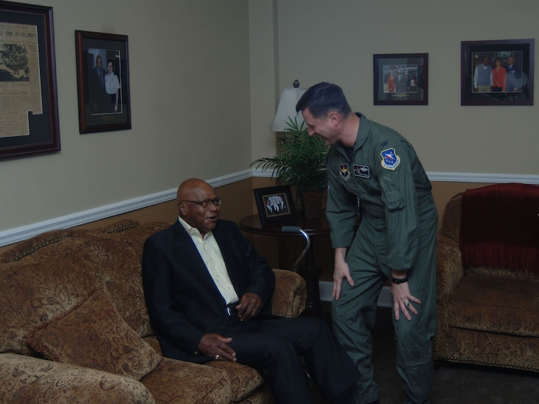 Colonel Mark Baker, 14th Flying Training Wing vice commander, greets Happy Irby in the Happy Lounge. Columbus Air Force Base officials helped him celebrated his 92nd birthday March 27.