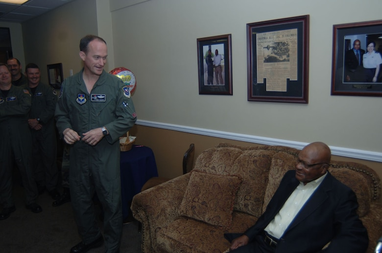 Colonel Dave Gerber, 14th Flying Training Wing commander, wishes Happy Irby a happy birthday in the Happy Lounge of the Columbus Club.  Columbus Air Force Base officials helped him celebrated his 92nd birthday March 27.