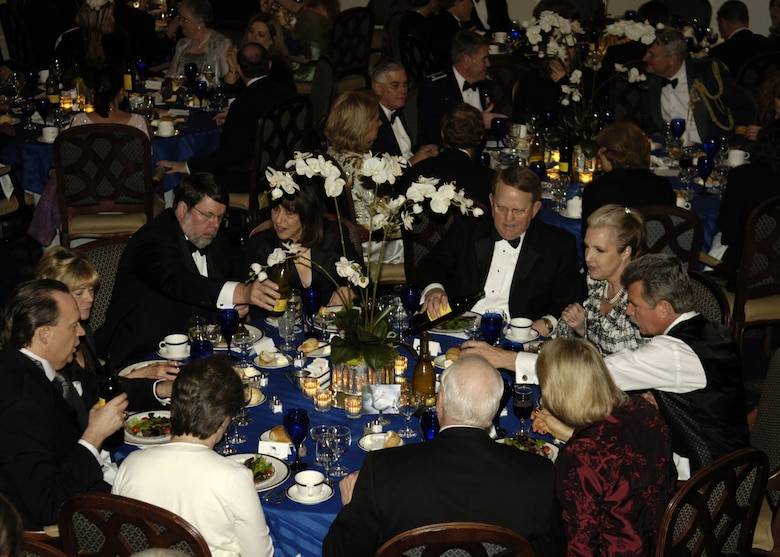 Members of the Air Force community eat a four-course meal prepared by enlisted aides at the fourth annual Air Force Charity Ball March 24 at the Bolling Clubs. (U.S. Air Force photo by Donna H. Parry)