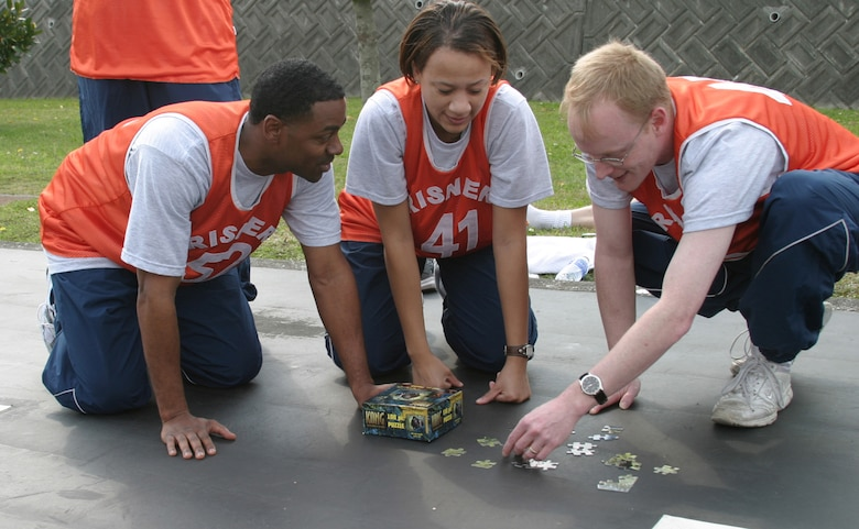 Members from the Erwin NCO Academy Phantom flight assemble a jigsaw puzzle during the puzzle relay phase of the NCO Academy/Airman Leadership School Combat Challenge March 14 on the Erwin Professional Military Education Center grounds. During this phase, members collected a puzzle piece from a pick-up point and delivered the piece to an assembly point until all 100 pieces were collected. This is the first combat challenge between the two schools.  (Air Force/Senior Airman Nestor Cruz)