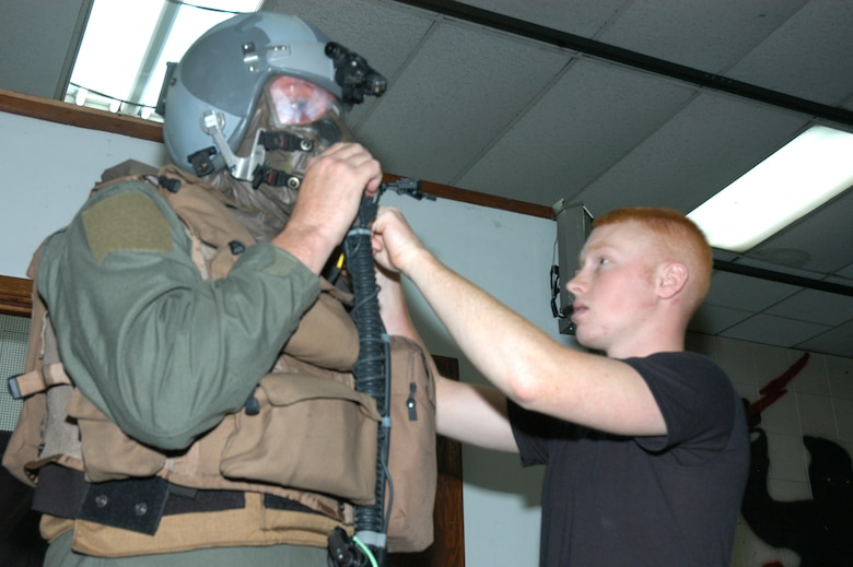 Airman 1st Class Christopher Randolph, 1st Special Operations Squadron life support technician, adjusts equipment for Master Sgt. Don Fannin, 17th Special Operations Squadron loadmaster, during training on the Aircrew Eye and Respiratory Protective System.  This training was part of the Blue Horizon Operational Readiness Exercise. More than 400 members of the 353rd Special Operations Group traveled to Daegu Air Base, Korea, for the exercise.    (Air Force/Master Sgt. Marilyn Holliday)