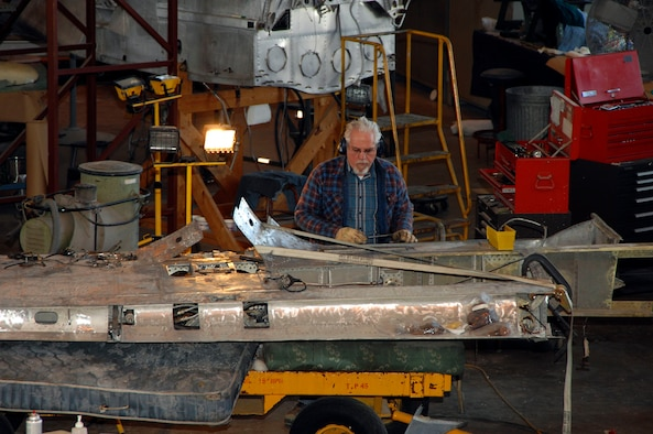 DAYTON, Ohio (02/2007) -- Restoration specialist Ray Petrusch works on a wing of the Japanese George in the restoration area of the National Museum of the U.S. Air Force. (U.S. Air Force photo)