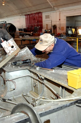 DAYTON, Ohio (02/2007) -- Volunteer Leroy Hendrickson works on the Japanese George aircraft wing in the restoration hangar at the National Museum of the U.S. Air Force. (U.S. Air Force photo)