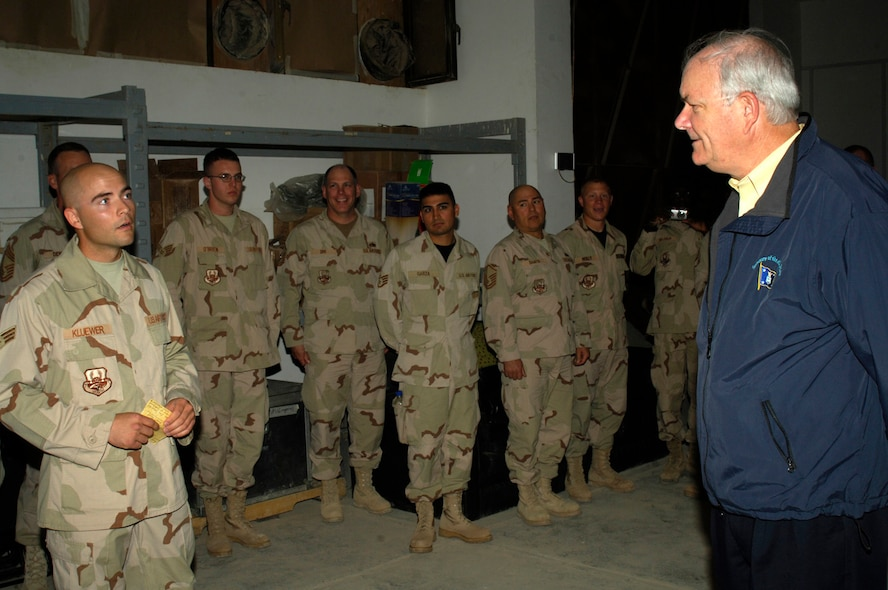 (ALI BASE, IRAQ) Honorable Michael Wynne, Secretary of the Air Force, receives a briefing from Senior Airman Byron Kluewer, 407th Air Expeditionary Group, during the Secretary's tour here Mar 28. (Courtesy photo)