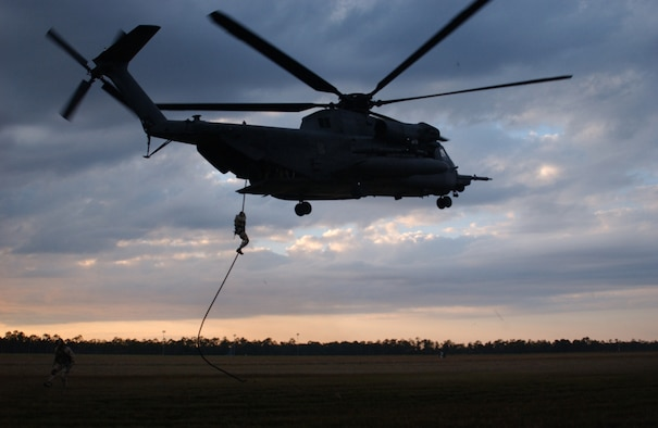Special operations forces practice fast roping from an MH-53 Pave Low of the 20th Special Operations Squadron at Hurlburt Field Fla.  Air Force Special Operations Command dominated the 2006 Air Force safety award program, garnering the service?s top awards for best major command safety record, most effective MAJCOM-level flight safety program and best ground safety program.  AFSOC officials said the awards were particularly significant because of the command?s challenging mission, requiring extensive low-level, night and all-weather flying. (Air Force photo by Chief Master Sgt. Gary Emery)