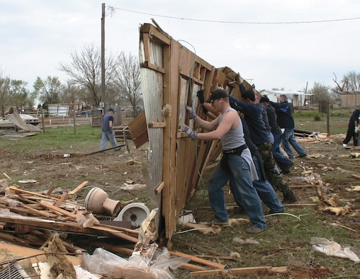 """CANNON AIR FORCE BASE, N.M. -- More than 500 Airmen from Cannon AFB have assisted Clovis, N.M., residents in storm clean up. A tornado hit the town, located six miles east of the base, March 23 leaving homes, property and businesses in ruin. Airmen will continue to assist in clean up efforts on an individual basis through the """"Airmen for an Afternoon"""" program. (U.S. Air Force photo/Airman 1st Class Thomas Trower)"""