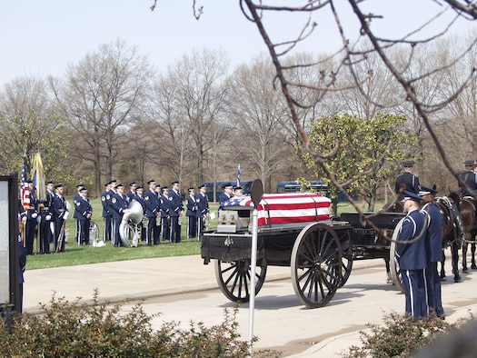 The U.S. Air Force Band's Ceremonial Brass performs a full-honors funeral at Arlington National Cemetery. (U.S. Air Force photo)