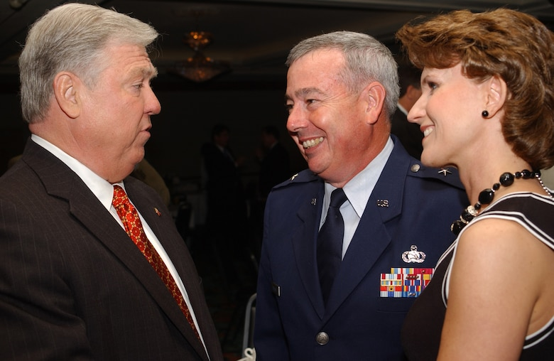 Governor Barbour chats with General and Laura Capasso following the general's recognition as one of 15 outstanding community leaders by The Sun Herald and the Journal of South Mississippi Business.  (U.S. Air Force Photo by Tech. Sgt. Chuck Marsh)