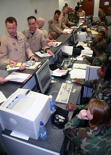 (TINKER AIR FORCE BASE, OKLA) Members of the 960th Airborne Air Control Squadron file through a processing line Mar. 27 as they prepare for an Operations ENDURING FREEDOM and IRAQI FREEDOM deployment. (Air Force photo by Staff Sgt. Stacy Fowler)