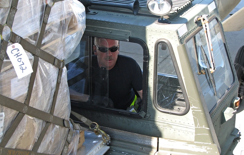 Staff Sgt. William Daniels, 53rd Aerial Port Squadron air transportation craftsman, drives a 60k loader on the flightline during the Patriot Partner Exercises Program. The program brought nearly 150 aerial port reservists to the base to work side-by-side with their active-duty counterparts. For the full story see Page 5. (U.S. Air Force photo by Chief Master Sgt. Wayne Hall)
