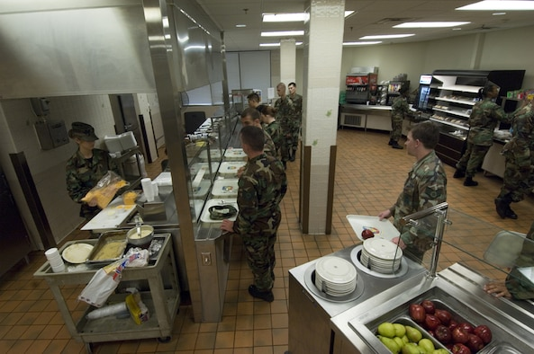 Airman Julia Morisoli, 23rd Services Squadron, (far left) fills the cheese container during the morning breakfast rush at Moody's Dining Facility March 30. Contractors and Airmen have been working to update much of the facility's infrastructure for the past two months.The main improvement involves the serving line; previously made of wood, it was replaced with stainless steel for sanitation reasons. (U.S Air Force photo by Staff Sgt. Manuel J. Martinez)