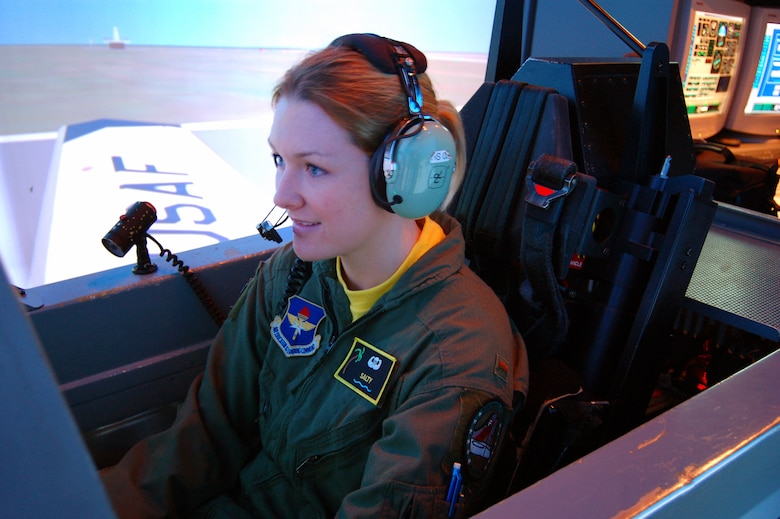 2nd Lt. Krissi Gage, 3rd Flying Training Squadron undergraduate student pilot, flies the last of more than 55,000 T-6A simulated student sorties here at Moody.  Her instructor, retired Col. Terry Cawley, also taught the very first T-6A simulator flight here in 2001. Moody's last T-6A UPT course ends March 30.  (U.S. Air Force photo by Tech.Sgt. Parker Gyokeres)