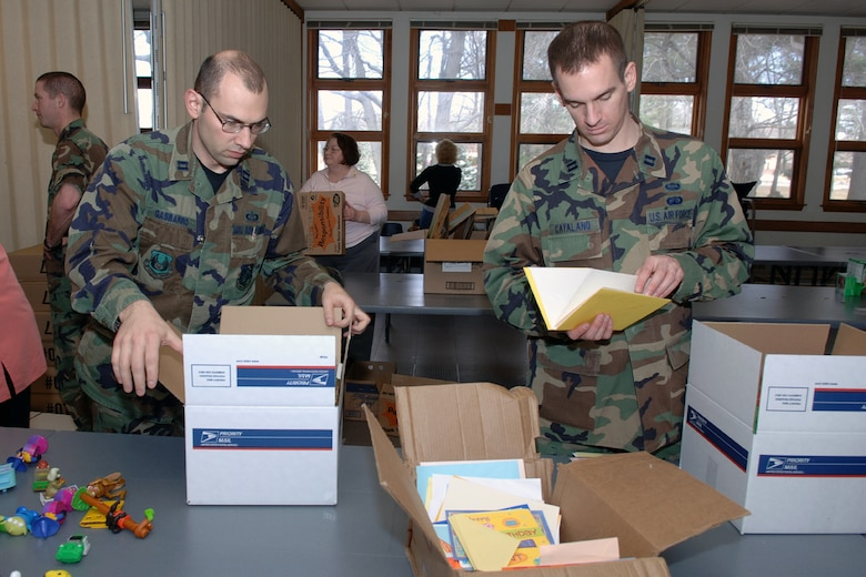 Capts. Marc Gasbarro and Christopher Catalano, both from the 551st Electronic Systems Wing, pack boxes with care during the Hanscom Troop Care Package drive.  (US Air Force Photo by Jan Abate)