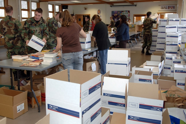 Hanscom personnel fill Troop Care packages at the Base Chapel Annex March 23. More than 700 boxes were shipped. (US Air Force Photo by Jan Abate)