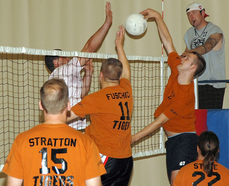 James Meador, a member of the 17th Training Support Squadron Tigers volleyball team, tips the ball around a 315th Training Squadron Bravo Rattlers defender during their volleyball match Tuesday at the Carswell Field House. (U.S. Air Force photo by Staff Sgt. Angela Malek)