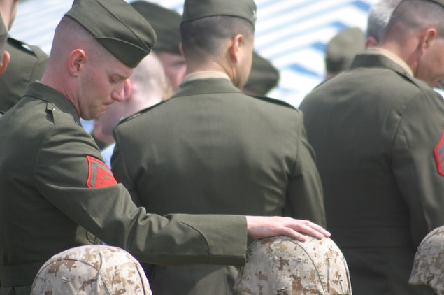 MARINE CORPS BASE CAMP LEJEUNE, N.C.- Marines with 3rd Battalion, 2nd Marine Regiment, 2nd Marine Division, honor the memories of 14 fallen brothers at a memorial ceremony here, March 31. These Marines made the ultimate sacrifice while honorably serving their country in support of Operation Iraqi Freedom in the Al Anbar province of Iraq. (Official U.S. Marine Corps photo by Cpl. Lucian Friel (RELEASED)