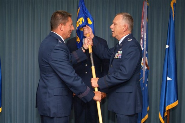 Col. Mark McClelland, commander 602nd provisional Training Group receives the 602nd TRG-P guidon from Maj. Gen. Mike Gould, 2nd Air Force commander.  The 602nd TRG-P was activated with Colonel McClelland as commander April 27.  (U. S. Air Force photo by Adam Bond)