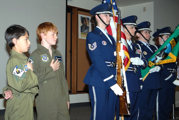 FAIRCHILD AIR FORCE BASE, Wash. -- Kevin Tsuchinda and Cameron Campbell recite the pledge of allegiance while accompanied by the 141st Air Refueling Wing's honor guard April 18. These two boys were treated to an orientation through the 141st ARW's Pilot for a day Program. (U.S. Air Force photo/Senior Master Sgt. Bob Thackston)