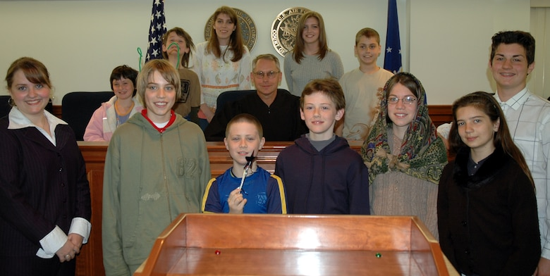 Bolling area homeschoolers pose with Col. Steve Thompson, Air Force appellate judge, after a mock trial at the Air Force Court of Criminal Appeals April 27. (U.S. AIr Force photo by Airman 1st Class R. Michael Longoria)