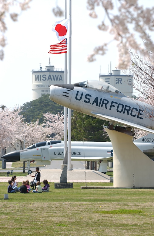 MISAWA AIR BASE, Japan -- Children play at Risner Circle on May 3, 2007.  Risner Circle, lined with Cherry Blossom trees, showcases a U.S. Air Force F-4 and F-86 jets, commemorating American and Japanese friendship. (U.S. Air Force photo by Airman 1st Class Benjamin Wilson)