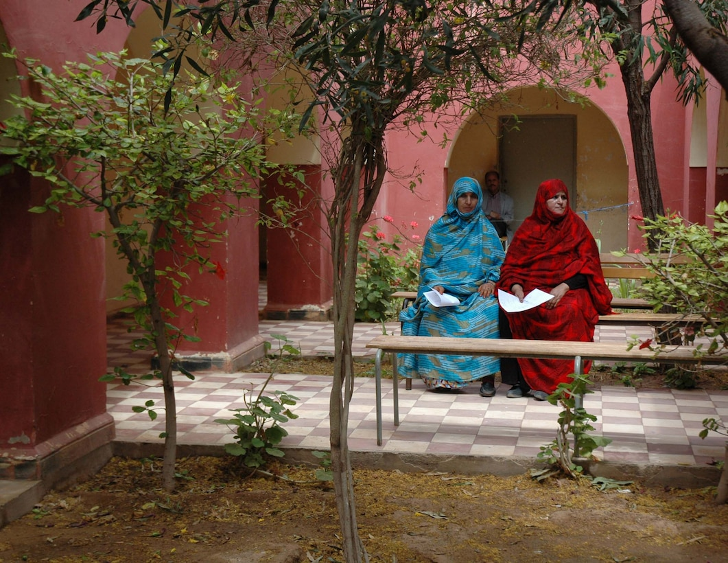 Two women from the village of Asrir, Morocco, wait to be seen April 23, by Moroccan and American doctors as part of exercise African Lion 2007. The 944th Medical Squadron team of 37 saw 3,746 patients in six days. (U.S. Air Force photo/Tech. Sgt. Susan Stout)