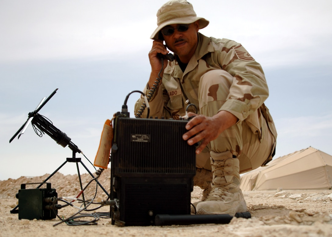 Master Sgt. Mike Rosado tests a multi-band satellite-communications-capable tactical radio used for secure tactical communications near Al Asad Air Base, Iraq. The radio is used for contingency operations and can be used nearly anywhere on the earth's surface. Sergeant Rosado is deployed from the 305th Communications Squadron at McGuire Air Force Base, N.J., and is the NCO in charge of expeditionary radio with the 438th Air Expeditionary Group. (U.S. Air Force photo/Capt. Ken Hall)