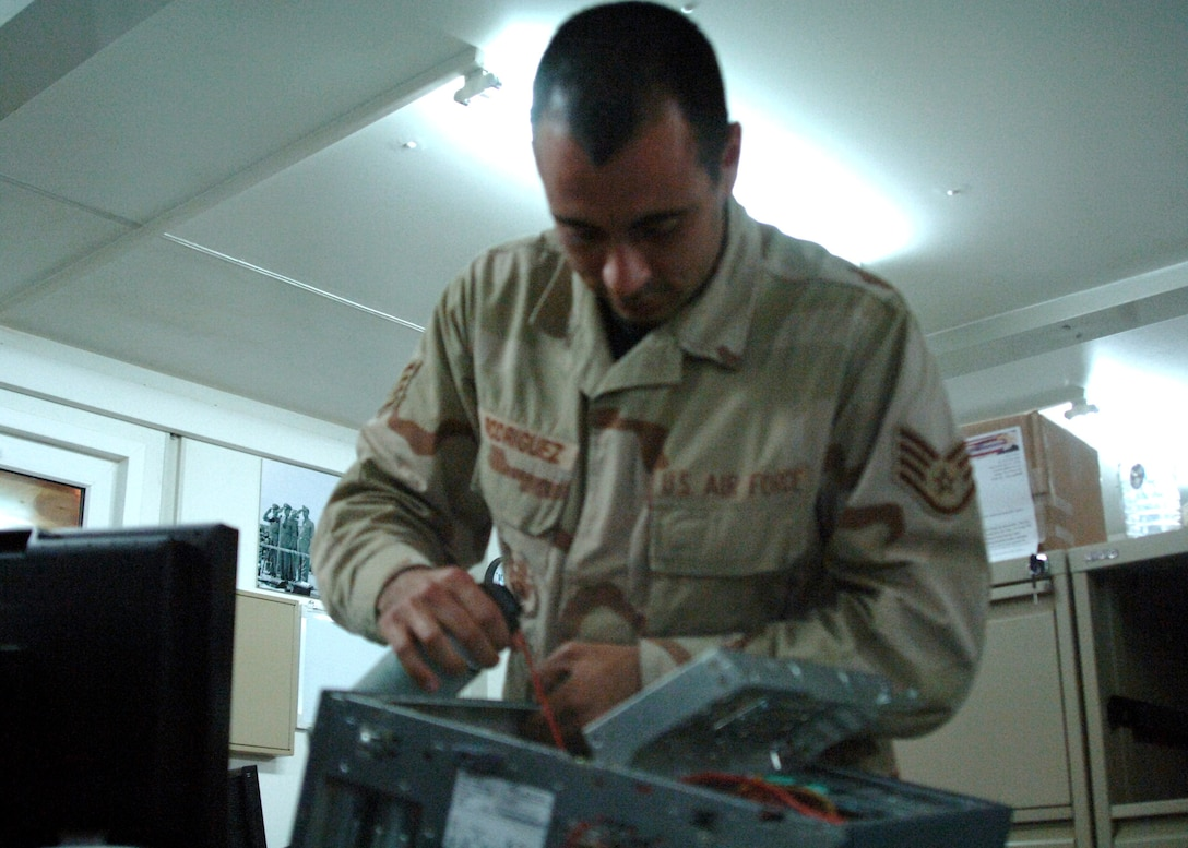 Staff Sgt. Mark Rodriguez cleans and troubleshoots computer equipment at Al Asad Air Base, Iraq. He deployed from the 71st Communications Squadron at Vance Air Force Base, Okla., and is assigned to the 438th Air Expeditionary Group. Sergeant Rodriguez is a computer systems specialist.  (U.S. Air Force photo/Capt. Ken Hall)
