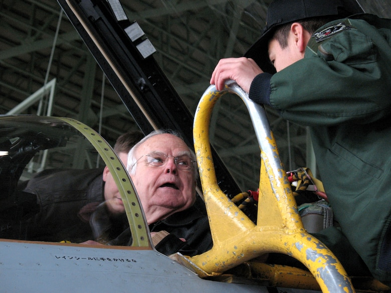 Retired Col. James Gilliland shares war stories with an RF-4C pilot from the Japanese Air Self Defense Squadron at Misawa Air Base, Japan. Colonel Gilliland flew 100 reconnaissance missions in the RF-4C during the Vietnam War. (U.S. Air Force photo/Senior Airman Gena Armstrong)