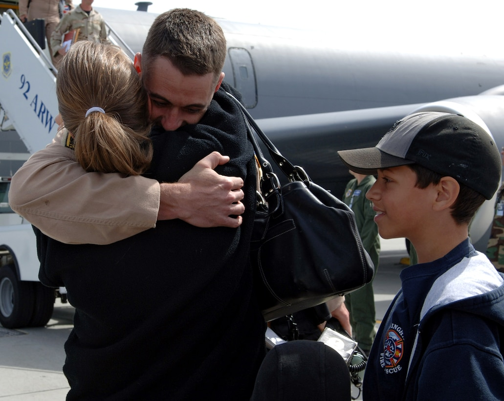 Capt. Brendan Voitik embraces his wife, Amy, after disembarking a KC-135 Stratotanker April 30 at Fairchild Air Force Base, Wash. Captain Voitik returned with 44 other Airmen after their deployment to support Operation Enduring Freedom at Manas Air Base, Kyrgyzstan. (U.S. Air Force photo/Airman 1st Class Jocelyn Ford)