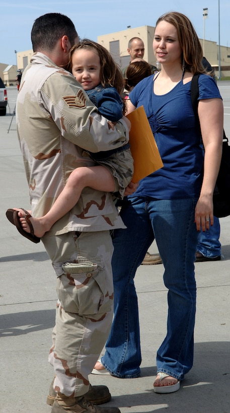 Jasmine Hernandez receives a big hug from her father, Tech. Sgt. Juan Hernandez, just minutes after his return April 30 to Fairchild Air Force Base, Wash. Sergeant Hernandez returned with 44 other Airmen from Manas Air Base, Kyrgyzstan. (U.S. Air Force photo/Airman 1st Class Jocelyn Ford)