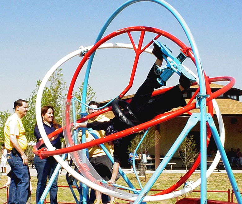 CANNON AIR FORCE BASE, N.M. - A gyro-flip ride spins a Kite Karnival-goer at the 4th annual event April 28 at Doc Stewart Park. An estimated 1,300 children and adultsfrom the base and local communities attended the festivities. (U.S. Air Force photo by Yolanda Romero)