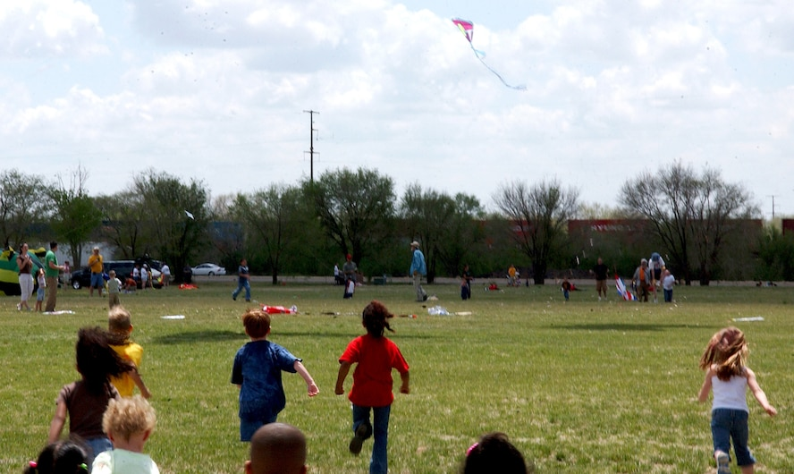 CANNON AIR FORCE BASE, N.M. - Children sprint for the pile of candy dropped from a kite during the 4th Annuall Kite Karnival at Cannon April 27. According to Community Center officials, more than 1,300 children and adults from the base and local communities attended  the festivites. (U.S Air Force photo by Airman 1st Class Thomas Trower)