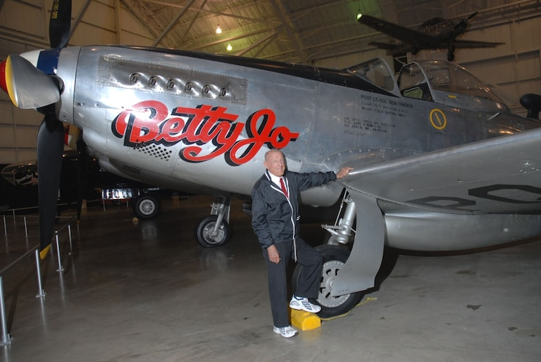 "DAYTON, Ohio -- Col. Bob Thacker stands beside the North American F-82B Twin Mustang at the National Museum of the United States Air Force. The museum's F-82B, ""Betty-Jo,"" flew from Hawaii to New York on Feb. 27-28, 1947, a distance of 5,051 miles, the longest non-stop flight ever made by a propeller-driven fighter. (U.S. Air Force photo)"