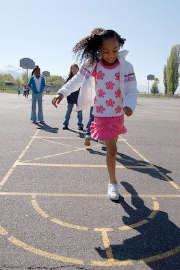 Desiree Palacios, Hill Field Elementary school student, plays hopscotch during recess. Playground games such as these are a good way for children to get exercise. For more about children's fitness, turn to page five. Photo by Beth Young