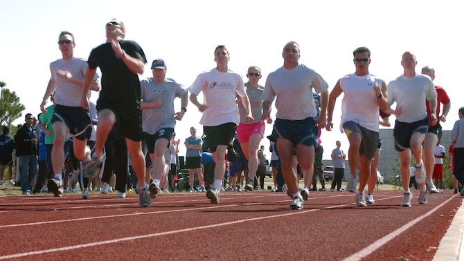SCHRIEVER AIR FORCE BASE, Colo. -- Runners take off at the start of the 4x1600-meter relay for the 4-Fit Challenge April 27. The 2nd Space Operations Squadron won the event with a time of 22:35. Overall, 4th SOPS won the 4-Fit Challenge with the most points. (U.S. Air Force photo/Staff Sgt. Don Branum)
