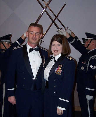 Capt. Christopher and wife Maj. Kimberly Tooman, both assigned to the 35th Fighter Wing Misawa Air Base, Japan take a moment to pose for a picture after the graduation ceremony following the Advanced Maintenance and Munitions Officer School. The AMMOS, located at Nellis Air Force Base, Nev., is a 14 week course offered to maintenance officers.