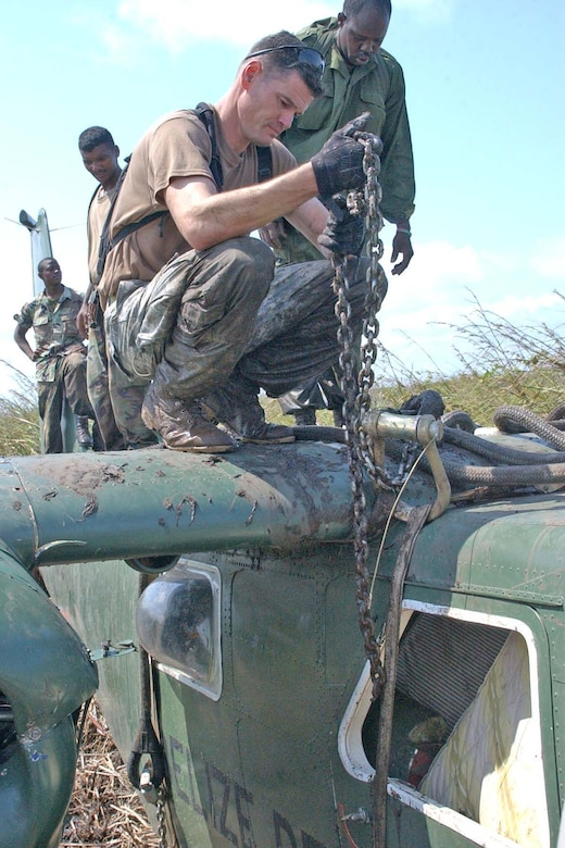 BELIZE CITY, BELIZE -- U.S. Army Sgt. 1st Class Mike Parks, 1st Battalion, 228th Aviation Regiment quality control noncommissioned officer in charge, counts the number of links on the chain-metal part of a slingload. The 25,000 pound slingload was used to lift a downed Belize Defence Force Defender aircraft out of a marsh May 3. (U.S. Air Force photo by Staff Sgt. Chyenne A. Griffin)