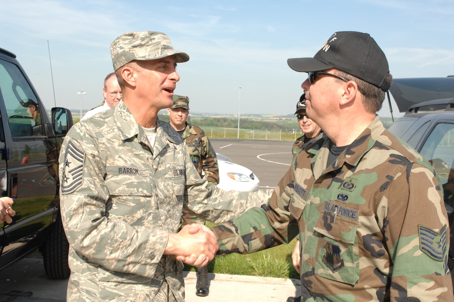 SPANGDAHLEM  AIR BASE, GERMANY-- Air Mobility Command Chief Master Sgt. Joseph Barron talks with Tech. Sgt. Michael Wolcott, 52nd Fighter Wing safety office, before taking a ride with him on Spangdahlem's new Saber Driving Course April 26. Chief Barron visited Spangdahlem for two days during a recent U.S. Air Forces in Europe trip. Initially, the Saber Driving Course training will be available to First Term Airman Center students age 26 years and younger. For more information on the Saber Driving Course, call the safety office at 452-7233. (US Air Force photo/Airman 1st Class Stephanie Clark)