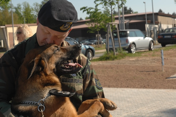 Staff Sgt. Robert Prim, 52nd Security Forces Squadron military working dog handler, and his male working dog, Judy, attended the opening of Spangdahlem's new veterinarian clinic April 27. Photo by Airman 1st Class Stephanie Clark.