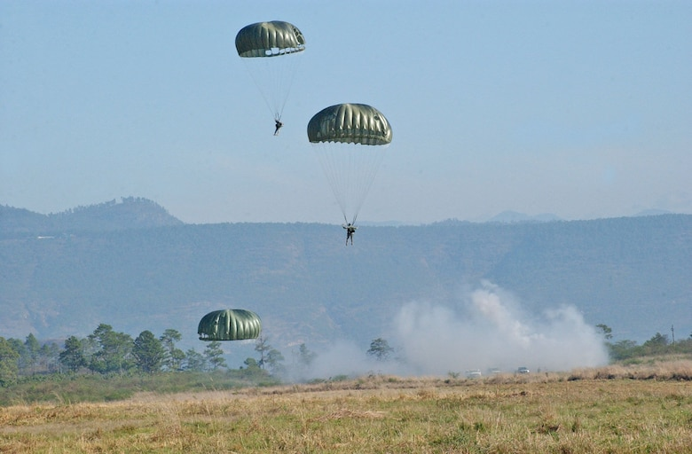 TAMARA DROP ZONE, Honduras – Paratroopers land on the drop zone during Iguana Voladora, an annual exercise that includes military members from across Central and South America.  Joint Task Force-Bravo hosted Iguana Voladora, an annual paratrooper exercise, April 29 through May 4 and hosted more than 50 paratroopers from Central and South America for the week.   (U.S. Air Force photo/Tech. Sgt. Sonny Cohrs)