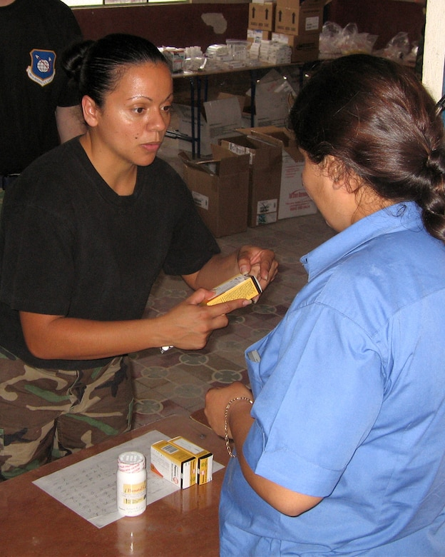 Staff Sgt. Nilsa Ramos, a pharmacy technician from Patrick AFB, Fla., dispenses medicine to a Guatemalan woman during a humanitarian mission to the area in the final 10 days of April.  The team of 13 medical professionals from Air Force Space Command saw more than 8,000 patients during that period. (U.S. Air Force Courtesy Photo)