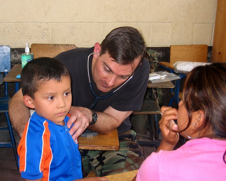 Maj. (Dr.) Michael Stevens, a pediatrician from Peterson AFB, Colo., listens to the heartbeat of a Guatemalan child as the boy's mother looks on.  Doctor Nelson was part of a team of 13 medical professionals from Air Force Space Command that was sent to Guatemala for a humanitarian mission during the final 10 days of April.  The team saw more than 8,000 patients during that 10-day period. (U.S. Air Force Courtesy Photo)