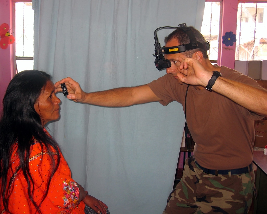 Lt. Col. (Dr.) Timothy Nelson, an optometrist from Vandenberg AFB, Calif., tests the eyesight of a Guatemalan woman.  Doctor Nelson issued more than 1,000 pairs of eyeglasses over the final 10 days of April during a humanitarian visit by 13 Air Force Space Command medical professionals.  The team saw more than 8,000 patients during that 10-day period. (U.S. Air Force Courtesy Photo)