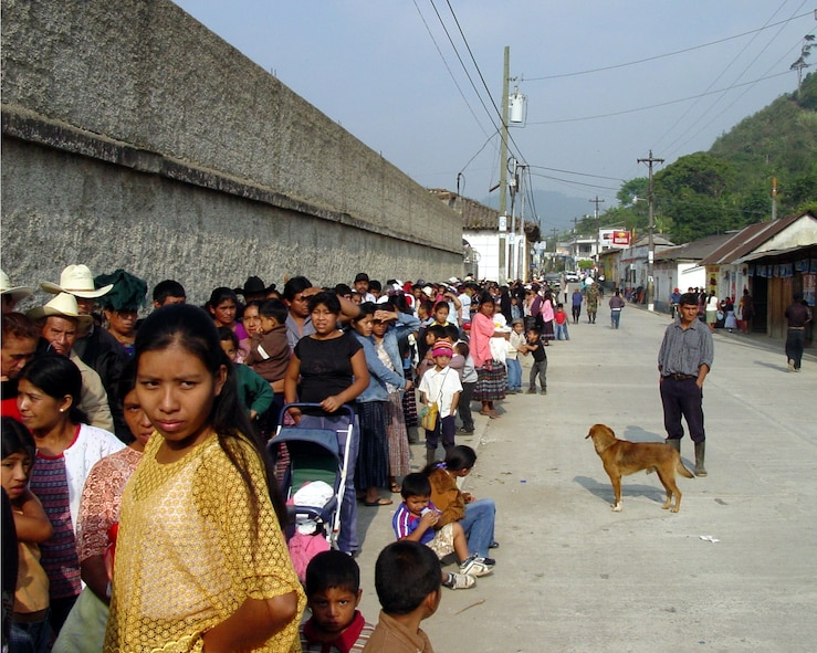 Guatemalan citizens line up around the block to receive some much needed medical attention.  Thirteen medical professionals from Air Force Space Command saw more than 8,000 Guatemalan patients over a 10-day period; with most of the patients standing in line for more than 12 hours.  (U.S. Air Force Courtesy Photo)