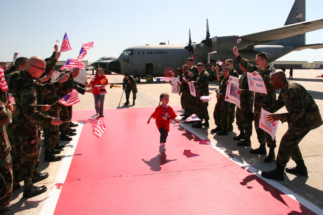 Riley Michaud, daughter of Capt. Matt Michaud, 393d Bomb Squadron, is welcomed home after a mock 'deployment' Saturday during Operation Spirit. The operation provided military children th opportunity to experience a 'deployment' at their level. (U. S. Air Force photo/Airman 1st Class Stephen Linch)