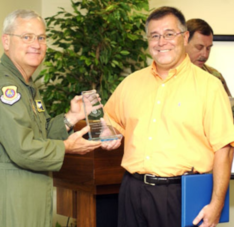 Brig. Gen. James Melin (left), 452nd AMW Commander at March Air Reserve Base, presents the AFRC Outstanding Weapons Safety Civilian of the Year award to Vic Flores. (U.S. Air Force photo by Staff Sgt. Amy Abbott, 452 AMW/PA)