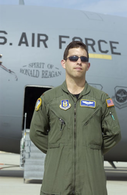 """2nd Lt. Charles Conder, from the 729 Airlift Squadron at March Air Reserve Base, stands in front of the """"Spirit of Ronald Reagan"""" C-17.  (U.S. Air Force photo by Staff Sgt. Amy Abbott, 452 AMW/PA)"""
